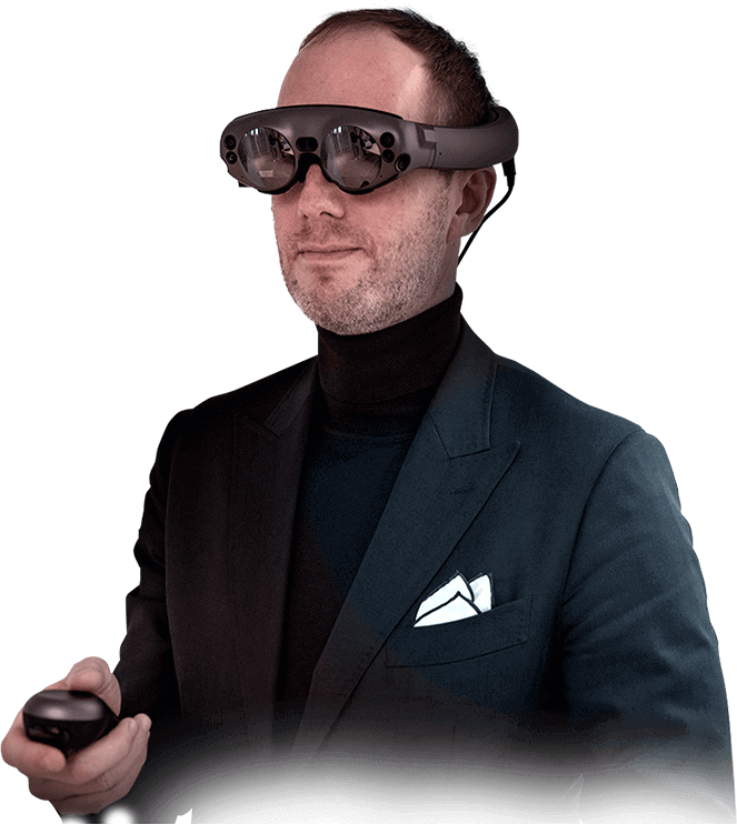 Prof. Bernd Lethaus, MD, wears mixed reality glasses and holds the controller