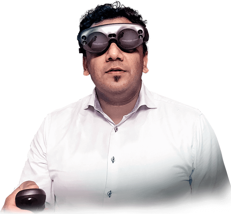 Majeed Rana, MD, wears mixed reality glasses and holds the system controller