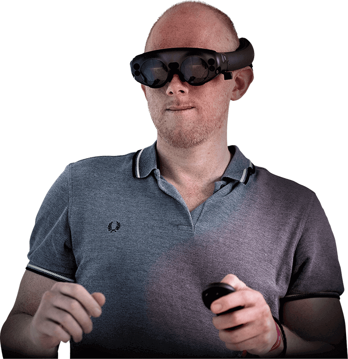 Morten Ziebell, MD, wears augmented reality glasses and holds the controller